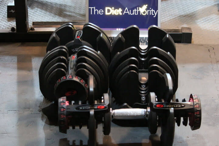 Bowflex 1090 Dumbbells with one dumbbell out of the cradle