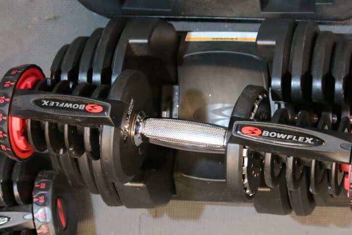 Bowflex dumbbell out of the cradle.