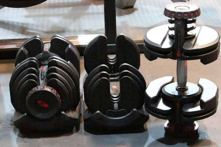 Bowflex SelectTech 1090 dumbbells with one sanding upright
