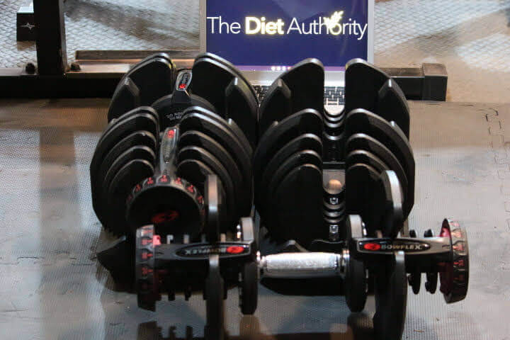My pair of SelectTech 1090 Adjustable Dumbells with one out ofthe cradle and The Diet Authority Logo in the background